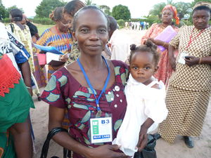 Woman holds baby in Africa