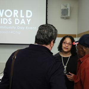 People speak at a conference for World Aids Day
