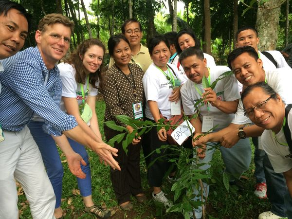 Staff and partners plant a tree in the Philippines