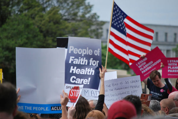 "Rally sign reading ""People of Faith for Health Care"""