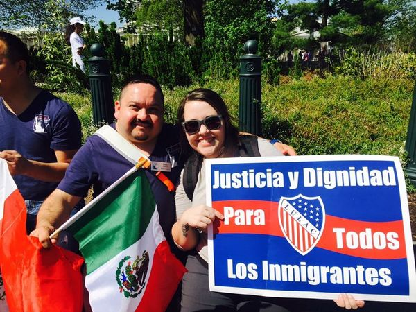 "GBCS Staff Amber Feezor poses with another attendee at an immigration rally. She holds a sign that reads, ""justicia y dignidad para todos los immigrantes"""