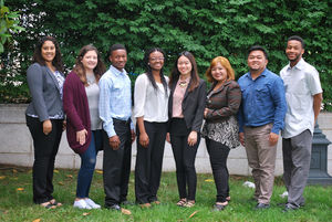 Eight ethnic young adult interns.