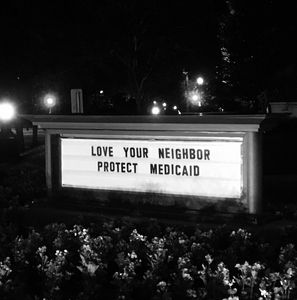 """Sign outside the United Methodist Building reads, """"Love your neighbor, Protect Medicaid."""""""