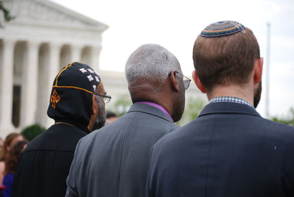 Three men of different faiths standing in front of the U.S. Supreme Court.