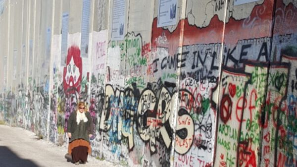 Janet Lahr Lewis by Separation Wall in Bethlehem