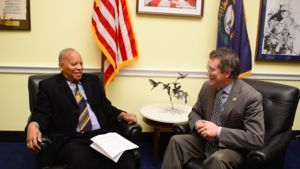 Harrison and Massie sit opposite each other in Massie's Capitol Hill office.