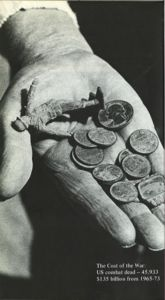 A wrinkled hand holds a few coins and a plastic army figure. The image includes the words: The Cost of War: US combat dead -- 45,993 $135 billion from 1965-73.