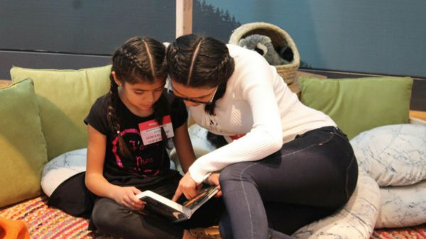 Children read at the San Fernando Valley Refugee Children Center