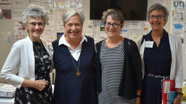 Bishop Johnson, Sister Norma, Bishop Dyck and Bishop Ward pose for a photo.