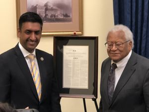 U.S. Rep. Ro Khanna and Rev. James Lawson stand next to the proclamation Khanna introduced to award Lawson with the Congressional Gold Medal.