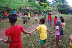 Children from the Philippines hold hands