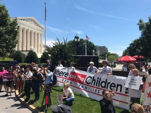 Protesters gather in front of the United Methodist Building in Washington D.C. to call for the closure of a family detention center in Homestead, Florida.