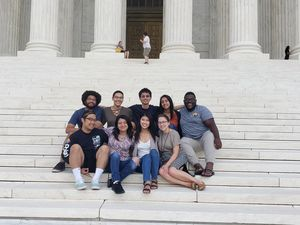 EYA interns pose for a group picture on the steps of the Supreme Court Building.