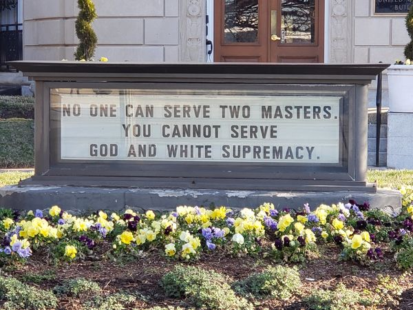 UM building sign - no man can serve two masters. you cannot serve white supremacy and god