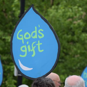 "A sign in the shape of a water drop that reads ""God's gift."""