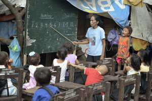 Indigenous children displaced by paramilitary violence attend school in a makeshift classroom in a church compound in Davao in 2016, on the southern Philippine island of Mindanao. Hundreds of Indigenous were living in the church center, afraid to return home.